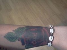My rose with leaves that wraps half way around my wrist. Yes it was a cover up from stupidity years ago. Well worth the money I paid to cover what was there.