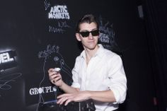 The fully greased-up Alex Turner leaves his mark on the Red Bull Sound Space's autograph wall.