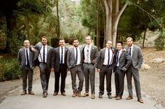 Grey groomsmen: their own grey suits. White shirts. Skinny ties. Brown belts and shoes. [Dos Pueblos Ranch Wedding by Braedon Flynn]