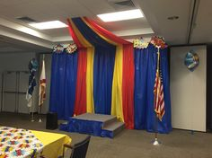 """Use rolls of plastic table cover to make a backdrop for a meeting or event! Takes a few hours to get up properly, but the """"wow factor"""" was worth it!"""