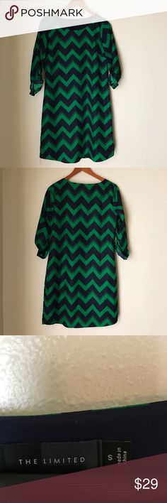 The Limited Kelly Green Navy Chevron Shift Dress This dress is preowned. It features a round neck and roll up midi sleeve. It  was originally paired a waist belt but is more flattering without. The belt loops have been removed. Also the dress does have a small stain on the lower back as well as the lining please refer to pic 5 and 6. It's 💯 % Polyester. 34inches long from shoulder.   Pair with a statement necklace and pumps. The Limited Dresses