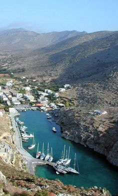 """Vathi -  our favourite little port on the island of Kalymnos.  It doesn't get much more sheltered than this!  And NOTHING beats Mama Sevasti's homemade dolmades at """"Poppy's Taverna""""..... :)     seascape-sail.com"""