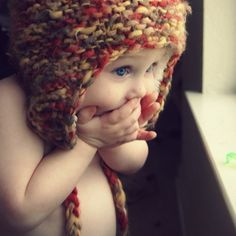 I don't know what's most adorable about this photo -- the body posturing and expression of this very cute baby, or the fact that he or she appears to be in their birthday suit wearing nothing but a snuggly knit hat.
