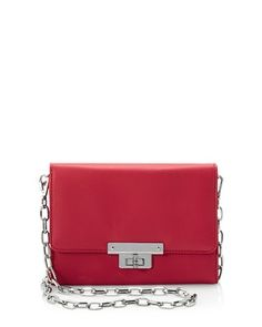Ravishing red crossbody bag with optional silvertone chain linked strap is both cute and compact while exuding sophistication in a clean silhouette.    Optional silvertone strap is removable with lobster closures.   Turn lock closure.    100% polyurethane.