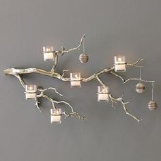 Try it with the natural coloration of the Manzanita and twine covering the wire on the candle holders.