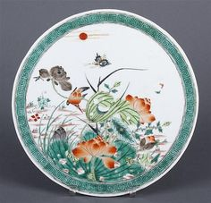 CHINESE PORCELAIN FAMILLE VERTE ROUND PLAQUE - Unmarked circular shape plaque with green border, having lotus flowers, lush foliage, hummingbird and butterfly decoration.