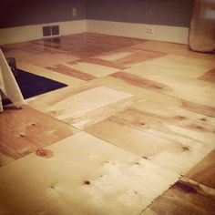 Plywood sheets, high gloss polyurethane and some elbow grease ❤ brand new inexpensive and beautiful flooring