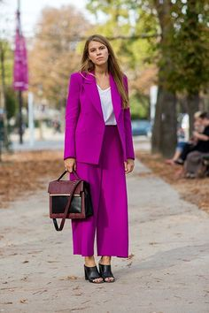 A culotte-style shape is modern, but still conservative. An aggressive color like fuchsia feels fresh, too. #refinery29 http://www.refinery29.com/new-suit-outfits#slide-2