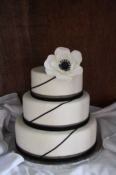 Black and white wedding cake - black and white wedding cake with a hand made gumpaste anemone flower