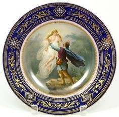 Antique ~ Royal Vienna ~ Austrian ~ porcelain ~ Hand painted portrait plate ~ Depicting a man with angelic maiden ~ Has magnificent scrolled gilded design to border with enamel beading over a cobalt background ~ Late 19th century ~ Early 20th century ~ Duke d'Antin of France Estate Auction