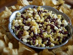 Bean-Corn-Feta Dip: Mix together… 1 can black beans, drained and rinsed 1 can white shoepeg corn, drained 4 oz. feta, crumbled 6 scallions, minced Whisk together… 1/4 cup apple cider vinegar 1/4 cup olive oil 1/4 cup sugar (start with less and add full amount if needed) 3 shakes garlic powder Pour dressing over bean mixture. Refrigerate until chilled, stirring every 30 minutes or so. Note: If you make it many hours in advance, wait to add the feta until just before serving.