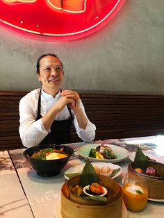 Chef Susur Lee in front of his culinary master pieces. Executive lunch and lunch prix fixe menus available at Luckee daily.