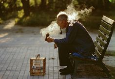 An old man with his pet bird in Ritan Park, Beijing, 1984  Thomas Hoepker
