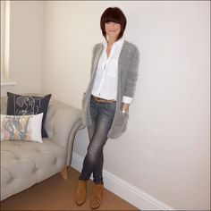 Grey oversized mohair cardigan teamed with a simple white shirt, grey skinny jeans & tan accessories