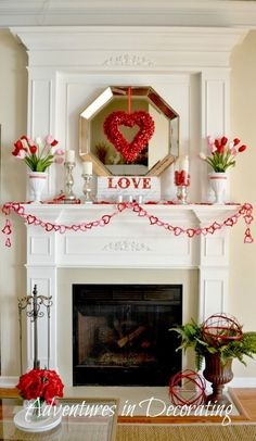 We're swooning for this red-hued Valentine's day decor! Easy mantel swag, and floral accents create a lovely design in this living room. Read more on the designHAPPY blog!