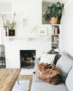 neutrals with green || white fireplace || grey sofa