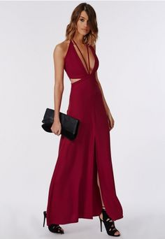 Standout this party season in this curve-hungry red stappy maxi dress.