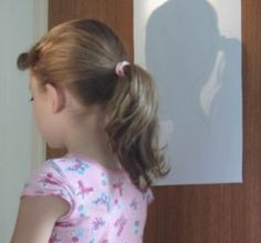 Silhouette Portrait Project - trace on white paper and let the child use various materials to decorate and express who they are.