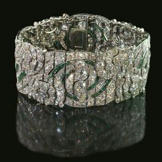 Now who wouldn't like this Deco bauble?    Art Deco Diamond and Emerald Bracelet ~ 1930 ~ Auger Frères nfs
