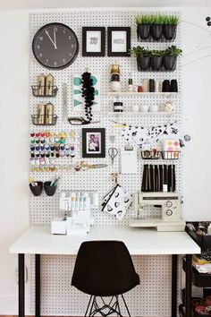 design-friendly and effective way to use wall space and a big piece of peg board