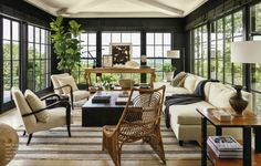 I'm in serious room love with this living room for its traditional yet cozy look. Those windows and that rattan chair are seriously incredible.