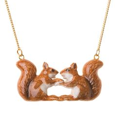 """Hand painted porcelain Kissing Squirrel necklace.  Our Kissing Squirrel is available on a 18"""" gold or silver plated brass based necklace."""
