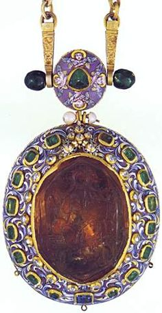 """Panagia """"Ecclesiastical Pendant"""" Russia, late 17th Century Silver, gold, emeralds (23.70 carats), uncut diamonds (3.88 carats), sapphire (4.50 carats), enamel 8 3/4 x 3 7/8 in (22.1 x 9.9 cm) From the Sacristy of the Monastery of the Savior, Yaroslavl Inv. No. YMZ-7895 The central gem is engraved with an icon of Christ enthroned. Engraved gemstones with icons."""
