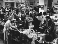 A scene taken from the 1954 comedy 'The Crowded Day' by John Guillermin. The film was centered around an department store but was actually shot at Bourne & Hollingsworth, Oxford Street, to give it authenticity. Built in 1894 and remodeled in an art deco style in 1928, much of the building's higher floors have survived as part of the Plaza Shopping Centre.