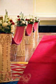 Aisle - want it in pink that matches base of stage with golden pillars along side with same floral arrangement on the mandap- want petals in either a design or scattered along the asile
