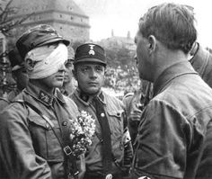 HeidiWolf: Budding National Socialist — scooteraz: Hitler speaking to a wounded...