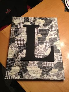 canvas board, mod-podge scrapbook paper, painted, wooden letter