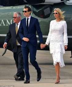 Jared and Ivanka though on sunglasses to shield their eyes from the son  ahead of their