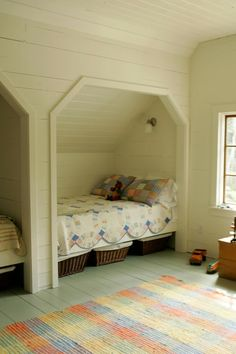 Neat idea for an upstairs room with a slanted ceiling. Love how the kids would have there own little nock you could even put a curtain up for them.