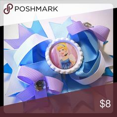 Cinderella Hairbow Brand new. 4.5 inches.  Blue and purple hairbow comes on an alligator clip.   Bundle and save!  Spend  $50 before shipping and get a FREE gift! Accessories Hair Accessories