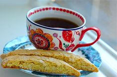 orange-almond biscotti and black coffee in a ridiculously pretty cup. perfect afternoon fare.