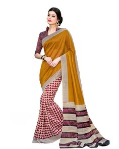 Mesmerizing Mustard  Silk  Saree Description: The Mesmerizing Mustard  Silk  Saree from Lurap is a must-have for your casual ethnic wardrobe. The printed silk saree comes with a contrast blouse in the same material. Wear it with gold jewelry for stepping out in style.  Details: Printed Work  Sizes Available: Saree Length- 5.5 meter Blouse Piece  Size upto 42 inches Blouse Piece Length- 0.80 meter  Colour and Fabric: Saree- Mustard, Blouse- Multi Color  and  Saree- Silk, Blouse- Silk