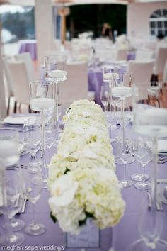 #purple wedding tables ... Simple column of white hydrangeas and orchids ... For a Reception Guide ... https://itunes.apple.com/us/app/the-gold-wedding-planner/id498112599?ls=1=8 ... plus how to organise your entire wedding ... The Gold Wedding Planner iPhone App ♥