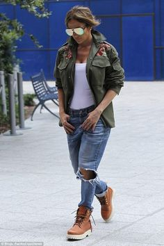 Jennifer Lopez wearing Gucci Boyfriend Straight Leg Jeans, Linda Farrow x 3.1 Phillip Lim 117 C3 Sunglasses, Valentino Green Embroidered Cotton Safari Jacket, Buscemi Lace Up Leather Site Boots and Wolford Jamaika String Bodysuit