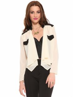Ivory and black chiffon blouse featuring front pocket caps and drape fit