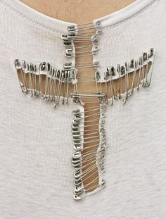 #DIY safety pin cross tee. hmmm not sure how I feel about this, maybe in the back of the shirt????