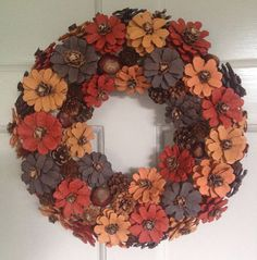 Pinecone door wreath. Handcrafted pinecone wall or door autumn wreath. Each pinecone is handcrafted and individually painted then mounted onto a 30cm polystyrene base. Orange, red, brown and yellow with natural pinecones and conkers. Suitable for indoor or outdoor decoration.