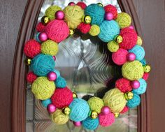 """Wreath, 14"""" Christmas yarn ball wreath in hot pink, lime green & turquoise."""