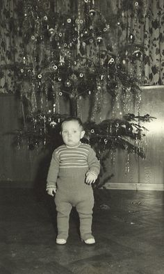 Baby in front of the Christmas tree...