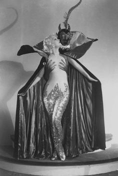 Actress Marian Martin in a Satan-themed burlesque cape. Martin actually played a dancer named 'Pinky Lee' in the 1943 film, 'Lady of Burlesque' which was based on the novel 'The G-String Murders' written by strip tease queen Gypsy Rose Lee. Martin was not a burlesque performer, but her costume is in the satanic burlesque spirit of this post. Actress Marian Martin and a burlesque cape featuring our pal, Satan, 1930s