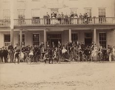 Group portrait of large group of men, women and children lined up with bicycles in front of and on balcony of the British Exchange Hotel in Goderich. Bicycles, Ontario, Balcony, British, Museum, Canada, Group, Portrait, Digital