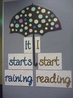 It starts raining, I start reading library display. I like the cute polka dots on the umbrella!