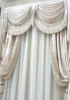 formal white swags with double layers. Custom draperies available DesignNashville.com  design service is complimentary