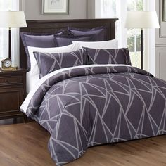 GEO - This striking print is colored in shades of grey with undertones of dark purple and highlighted with white geometric motifs.It is a unisex d...