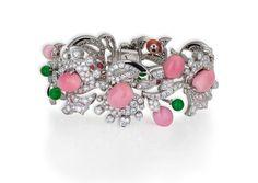 David Morris. Natural conch pearl, jade, onyx & diamond flower motif bracelet. Total diamond weight 16.74cts Total conch weight 55.19cts. Photo courtesy David Morris.  (source http://www.davidmorris.com)