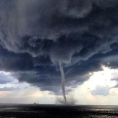 Image from http://www.tampabay.com/resources/images/dti/rendered/2013/07/waterspout2_11227283_8col.jpg.